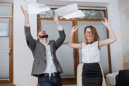Triumphant office worker succeeded in striking a good deal. Happy businessmans. Good job Reklamní fotografie