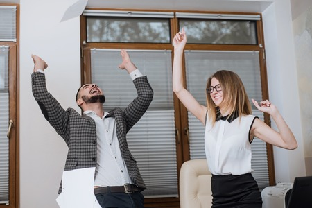 triumphant: Triumphant office worker succeeded in striking a good deal. Happy businessmans. Good job