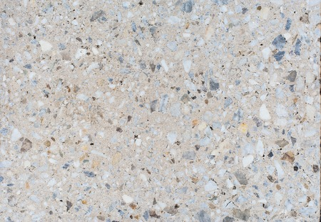 The texture or background of a light granite tile interspersed with stone for design. Granite slab, marble texture 写真素材