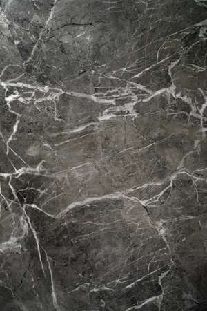 Porcelain stoneware with a high-resolution natural stone texture. The texture or background of natural marble.