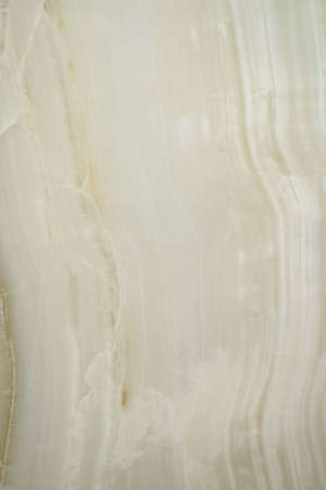 Ceramic porcelain stoneware tile texture or pattern. Natural stone cream color with veining