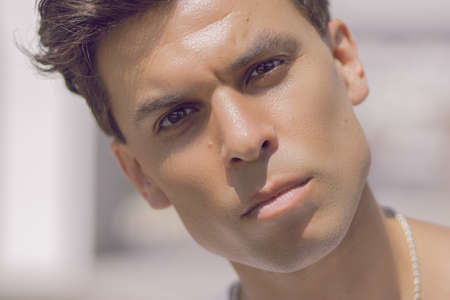 Close-up of a man's face with a piercing gaze