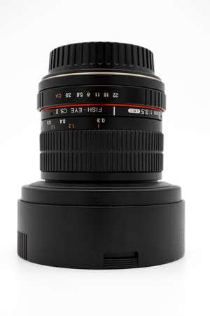 Black fisheye lens on white background close up