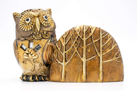 Sheet for notepad storage of notes, in a statue of an owl on a white background Stock Photo