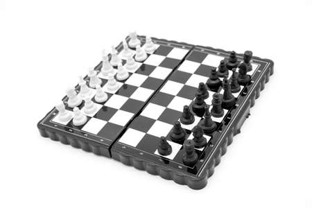 Pocket plastic chess game, checkers on magnets isolated on white background