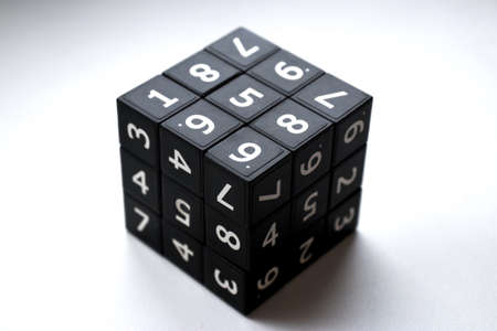 Black cube with numbers in its area for playing the Japanese Sudoku game on a white background Banque d'images