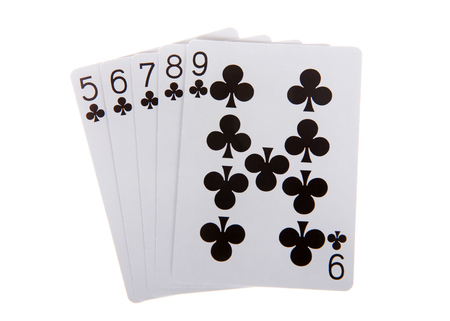 Playing cards, a straight flush. A straight flush is a five card sequence of the same suit. Clubs Stock Photo