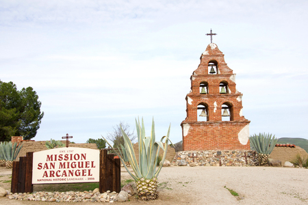 San Miguel, CA - January 13, 2019: Sign on side of road for Mission San Miguel Arcangel, a Spanish mission established on July 25, 1797 by the Franciscan order.