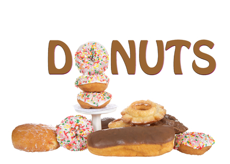 Variety of Donuts isolated on white background with word DONUTS above pile, using a sprinkle donut for the O. Imagens