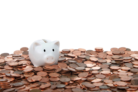 One small white piggy bank sitting on a landscape of old and new pennies isolated white. With the collapse of the zinc market, the penny has become cheaper to make, costing the taxpayer much less.