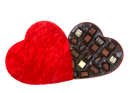 Heart shaped box with chocolate candies isolated on white background. A popular gift for Valentines Day.