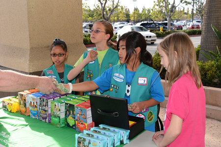 Irvine, CA - February 15, 2013: Girl Scout cookie booth sale, helping girls build confidence, public speaking skills, marketing, working as a team and learning to handle rejection to name a few.