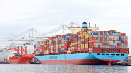Oakland, CA - January 07, 2019: Cargo Ships loading at the Port of Oakland, which loads and discharges more then 99 percent of containerized goods moving through Northern California.