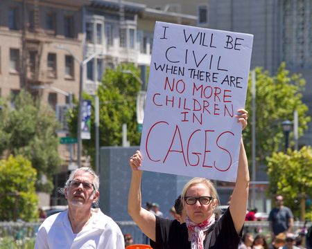 San Francisco, CA - June 30, 2018: Thousands of protestors in a Families Belong Together march to City Hall, protesting Trumps Zero Tolerance policy and the separation of more that 2,000 children Editorial