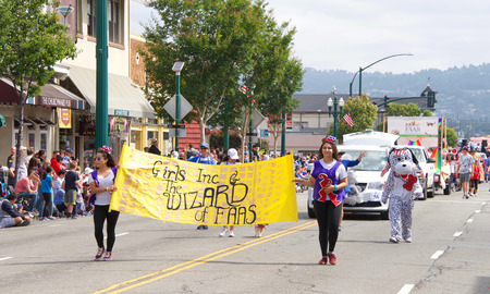 Alameda, CA - July 04, 2018: The Alameda 4th of July Parade is one of the largest and longest Independence Day parade in the nation. Unidentified participants from Girls Inc and Friends of the Alameda Animal Shelter. Editorial