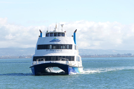 San Francisco, CA - November 24, 2018: The San Francisco Bay Ferry provides passenger service from Oakland and Alameda to the Ferry Building, Pier 41, Angel Island, and Oyster Point in San Francisco.