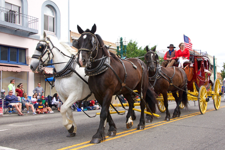 Alameda, CA - July 04, 2018: The Alameda 4th of July Parade is one of the largest and longest Independence Day parade in the nation. Wells Fargo covered wagon drawn by horses past the crowd