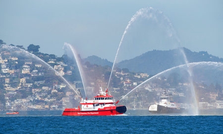 San Francisco, CA - October 05, 2018: Fireboat 3 leading the Parade of Boats at the 37th annual Fleet week in San Francisco. The vessel has an 18,000 gallon per minute pumping capacity. 写真素材 - 116659872