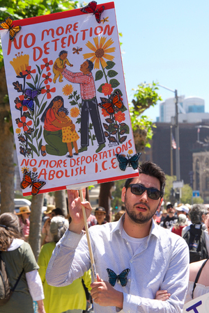 San Francisco, CA - June 30, 2018: Thousands of protestors in a Families Belong Together march to City Hall, protesting Trumps Zero Tolerance policy and the separation of more that 2,000 children Редакционное