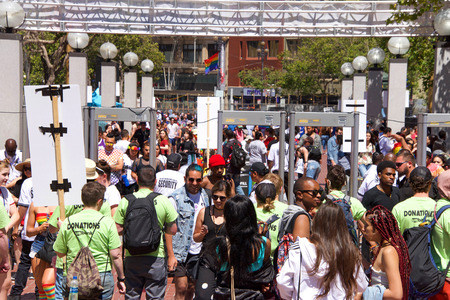 San Francisco, CA - June 23, 2018: Participants at San Francisco Pride, one of the largest gatherings of the LGBTQ Community and its allies in the nation. Security checkpoint to enter the festival.