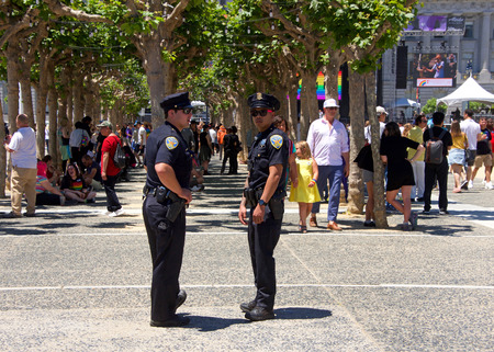 San Francisco, CA - June 23, 2018: SF Police officers patrolling at San Francisco Pride Festival, one of the largest gatherings of the LGBTQ Community and its allies in the nation.