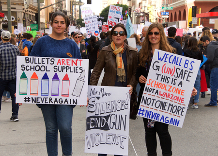 Los Angeles, CA - March 24, 2018: With calls to End gun violence, no more silence!  thousands of students and adults march to protest gun violence. March for our lives.