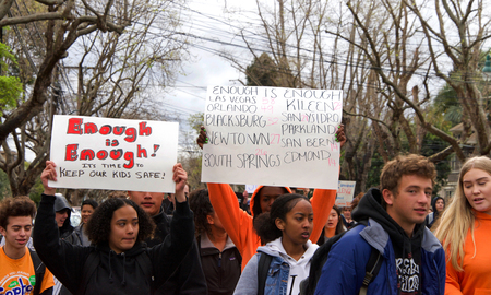 """Alameda, CA - March 14, 2018: With calls to """"End gun violence, no more silence!"""" hundreds of students from Alameda High School participate in a student walkout to protest gun violence. Editorial"""