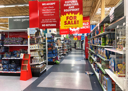Emeryville, CA - March 10, 2018: Emeryville Toys R Us closing sale store aisles. Bankrupt retailer Toys R Us may shut all its US stores as soon as next week, according to several reports.