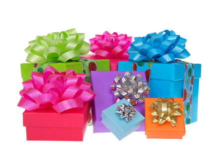 Many brightly colored boxes presents with colorful bows. Holiday shopping wrapped. Isolated on a white background. 免版税图像