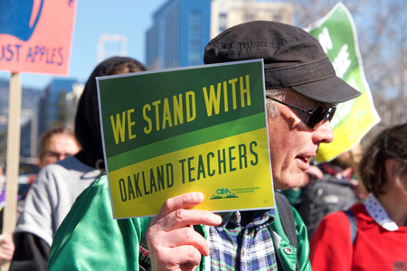 Oakland, CA - February 21, 2019: Oakland teachers strike outside of Oakland Technical High School, then marching to city hall. Fighting for smaller class sizes and bigger paychecks. Editöryel