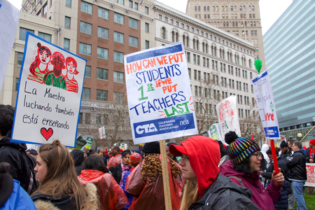 Oakland, CA - February 25, 2019: Unidentified participants at Oakland teachers strike day 3 rallying at Frank Ogawa Plaza. Fighting for smaller class sizes and bigger paychecks. Editorial
