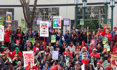 Oakland, CA - February 28, 2019: Unidentified participants at Oakland teachers strike day 6 rallying at Frank Ogawa Plaza downtown. Fighting for smaller class sizes and bigger paychecks.