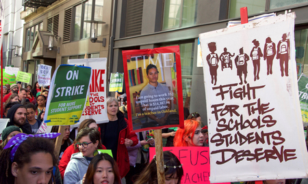 Oakland, CA - February 28, 2019: Unidentified participants at Oakland teachers strike day 6 rallying at Frank Ogawa Plaza marching through the state building. Fighting for smaller class sizes and bigger paychecks. Editöryel