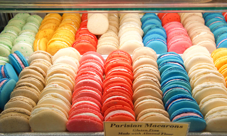display case with a colorful variety of Parisian macaron cookies, Gluten free, made with almond flour. Stok Fotoğraf