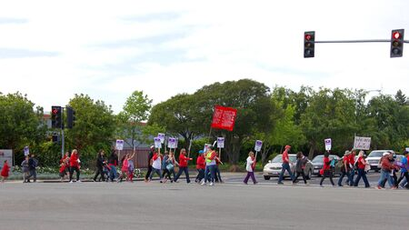 Union City, CA - May 22, 2019: Teachers and students march to the New Haven School District Educational Services Center to protest. The 1st teachers strike ever at New Haven Unified's schools i