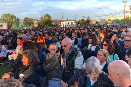Oakland, CA - July 31, 2019: More than 6500 people pack the soccer field at Lany College as Democratic hopeful, Elizabeth Warren, outlines her plans for government.