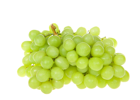 bunch of green grapes isolated on white. Grapes can be eaten fresh, or they can be used for making wine, jam, juice, jelly, raisins and a variety of other products. Archivio Fotografico