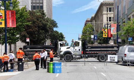 San Francisco, CA - June 29, 2019: Security and a truck barricade at the annual San Francisco Gay Pride Festival, at Civic Center in downtown San Francisco. Theme Generations of Resistance.