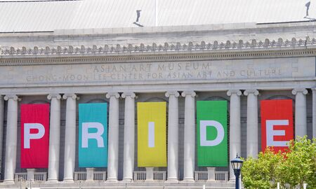San Francisco, CA - June 29, 2019: PRIDE sign on the side of the Asian Art Museum for  the annual Gay Pride Festival, at Civic Center downtown. This years them, Generations of Resistance. 報道画像