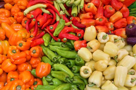 top view flat lay of various peppers on table at Farmers Market. Reklamní fotografie