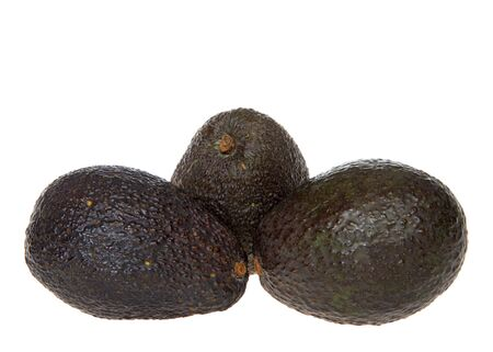 whole avocados isolated on white background. Avocados are grown commercially in parts of Florida, California and Hawaii.