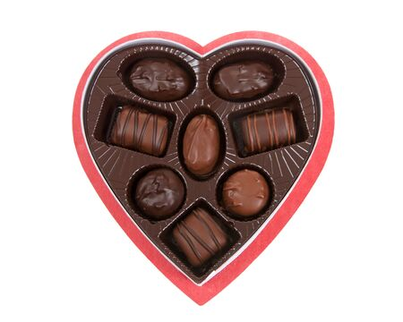 Heart shaped box with chocolate candies isolated on white background. A popular gift for Valentine's Day.