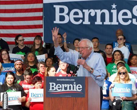 Richmond, CA - Feb 17, 2020: Presidential candidate Bernie Sanders speaking at a rally in Richmond. Asking CA voters to make sure to vote, and for No Party Preference voters register democrat and vote Archivio Fotografico - 140920026