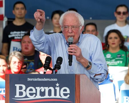Richmond, CA - Feb 17, 2020: Presidential candidate Bernie Sanders speaking at a rally in Richmond. Asking CA voters to make sure to vote, and for No Party Preference voters register democrat and vote Archivio Fotografico - 140920034