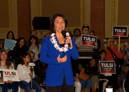 San Francisco, CA - Feb 29, 2020: Presidential candidate Tulsi Gabbard, U.S. Senator, speaking to a standing room only crowd at a town hall inside the Hibernia Bank building. Editoriali