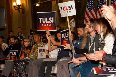 San Francisco, CA - Feb 29, 2020: Unidentified people seated waiting inside The Hibernia Bank building to hear Presidential candidate Tulsi Gabbard speak at a Town Hall meeting.