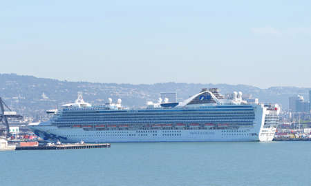 Oakland, CA - March 12, 2020: Grand Princess cruise ship docked at the Port of Oakland, unloading passengers impacted by the COVID-19 Corona virus.