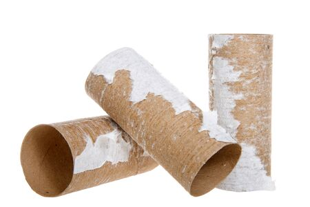 Three empty rolls of toilet paper laying isolated on white background