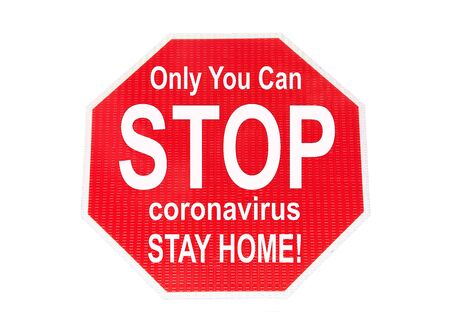 Stop sign isolated on white with message Only You can STOP coronavirus STAY HOME! Corona Virus pandemic sweeping across the United States and the world, killing millions