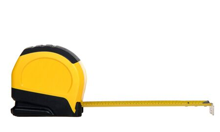 One yellow and black tape measure with tape extended 6 inches, isolated on white background. Common tool in construction.